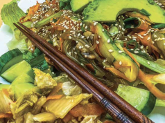 Korean vegetable stir fry featuring chopsticks
